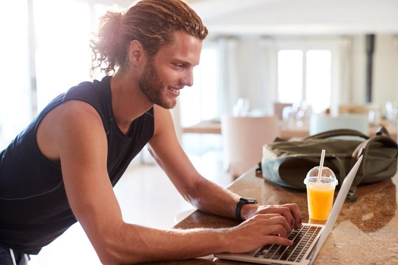 millennial-white-man-checking-fitness-app-on-lapto-9WV83CN.jpg
