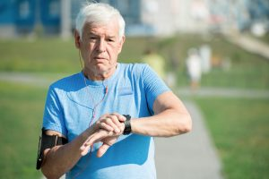 Senior Man with Fitness Gadgets